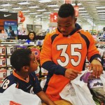 Kapri Bibbs donating time and gifts to the youth