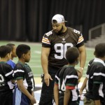 Billy playing with the youth during a play 60 event